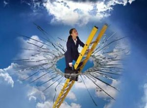 woman on a ladder through shattered glass