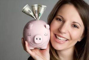women smiling with piggy bank